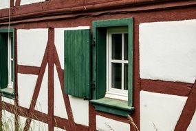 green shutters of a timber framed house