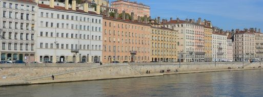 old apartment buildings on embankment, france, lyon