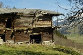 dilapidated wooden house on a hill