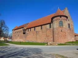Medieval castle on a background of a bright blue sky