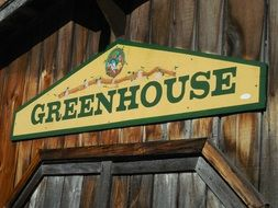 sign greenhouse wood wall building
