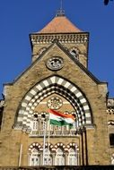 Indian flag on the background of a historic building