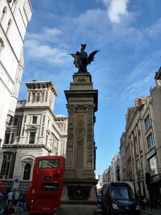 Monument and the red bus on Fleet Street in London