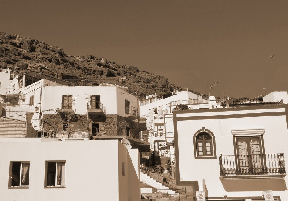 monochrome picture of old village on mountain side, spain, canary islands