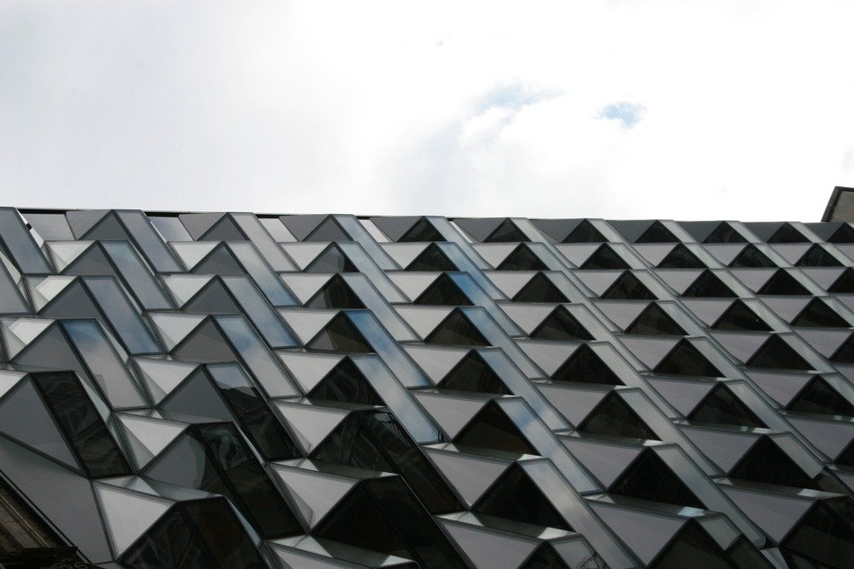 glass facade of a building with an abstract pattern
