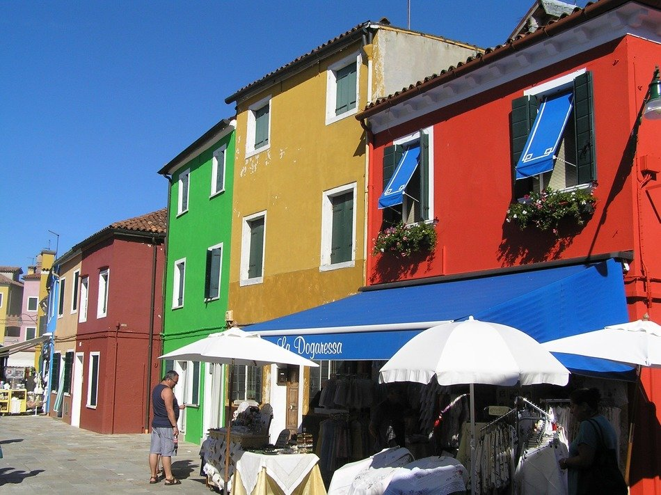houses with colorful facades in the quarter of Burano in Venice