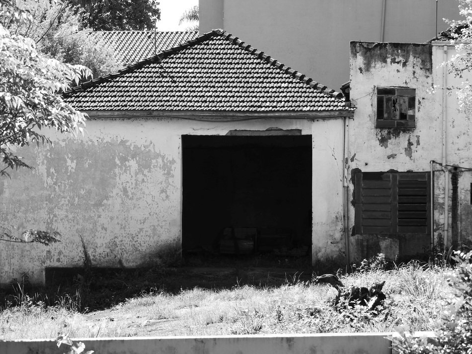 black and white image of an abandoned house