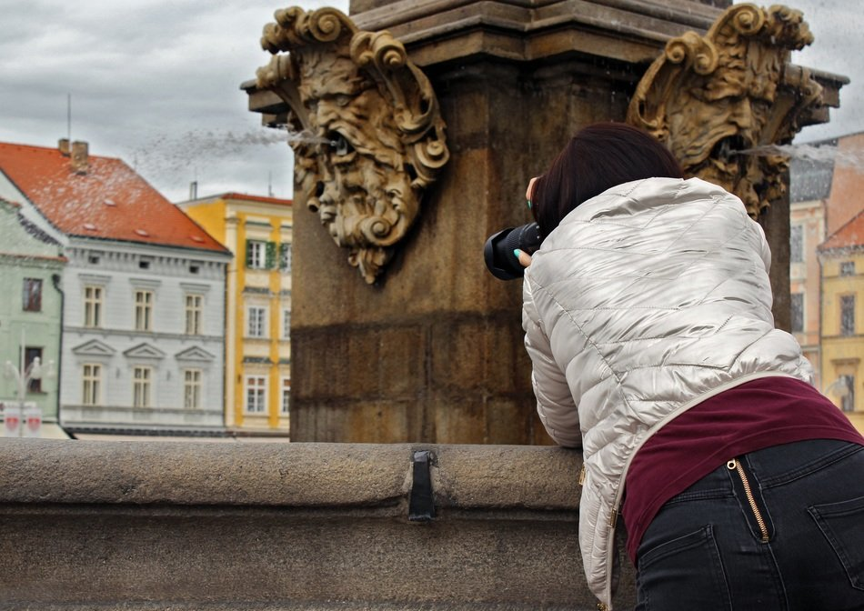 fountain czech budejovice girl taking pictures