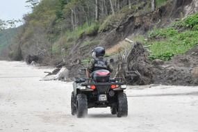 the border guard on sand beach riding