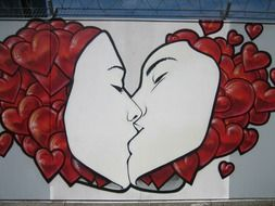 graffiti in the form of a kissing couple