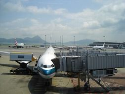 airplane landing passengers at hong kong airport