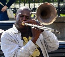 dark skin jazz musician on street