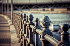 Iron railing on bridge