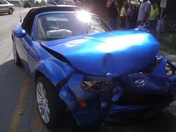 blue Mazda after the accident
