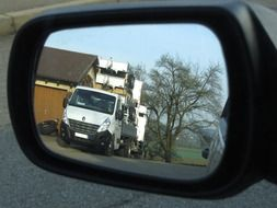 road is reflected in the side view mirror