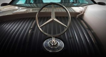 silver logo of a brand mercedes benz