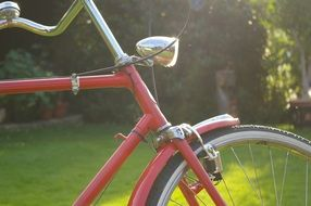 Red bicycle in the sun