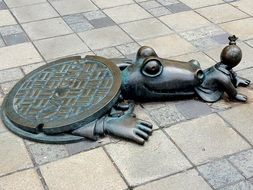 Crocodile swallowing capitalist- monument in New York