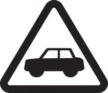 triangular sign with the image of a car