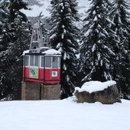 cable car in the winter forest
