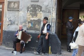 two old street musicians, ukraine, lviv