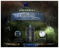 old green police car