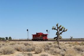 locomotive on railroad in mojave desert
