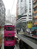 double-decker bus on the road in hong kong