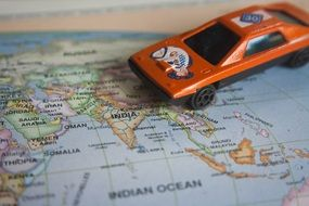 road trip world map toy car auto