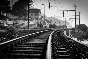 black white photo railroad tracks