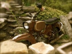 old motorcycle near the stones in a blurred background