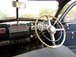 wheel on the panel in a retro car