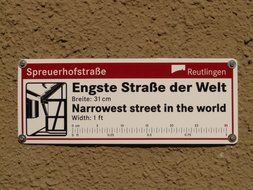 sign about the narrowest street in the world