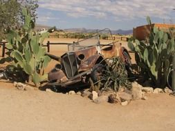rusty car in the desert in Namibia