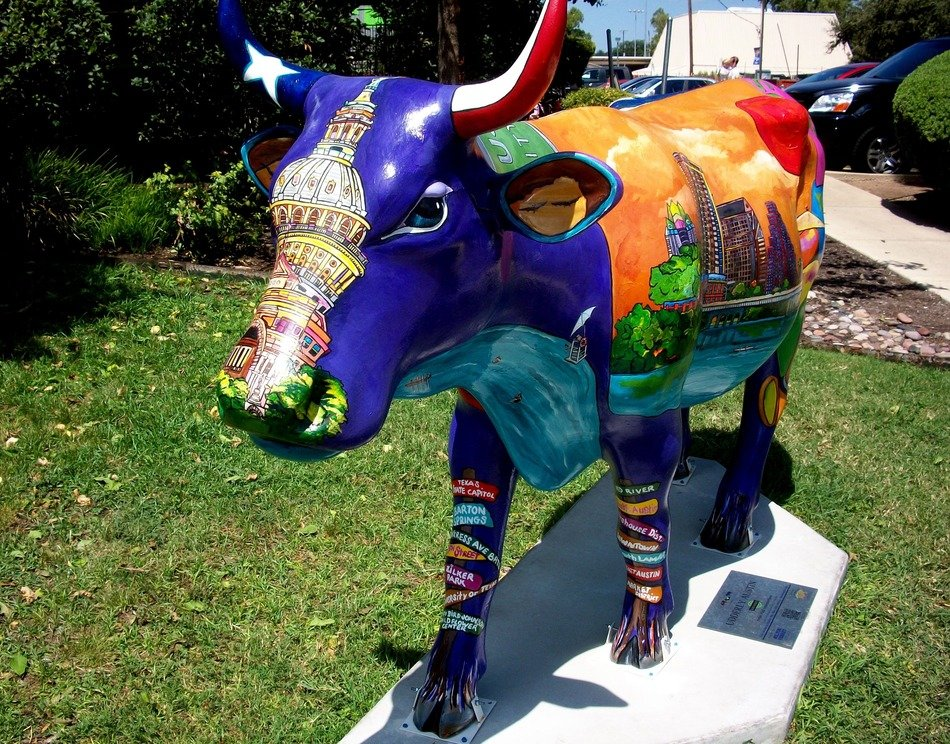 street sculpture in the form of a colored cow