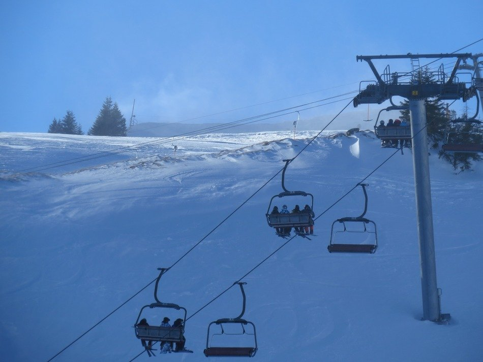 ski lift on a snowy hill