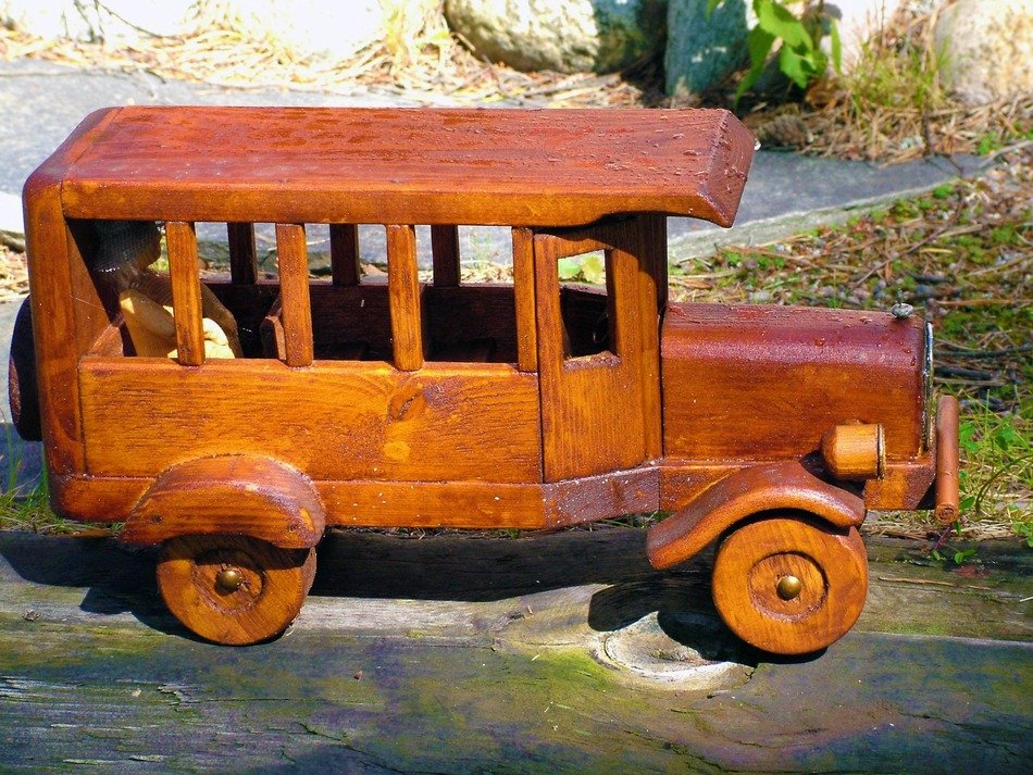 decorative wooden car in the garden