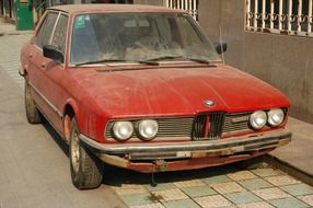 rusty red car BMW