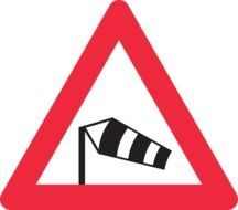 high wind warning on road sign