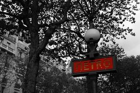 Metro sign on a street lamp