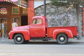 old red pickup truck on a road