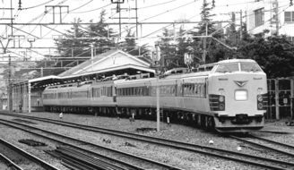 black and white photo of a japanese train