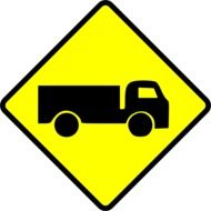 painted warning sign depicting a truck