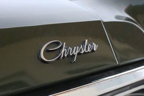"brand name ""Chrysler"" on a car"