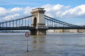No overtaking sign on danube river in front of bridge, hungary, budapest