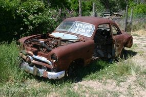 abandoned rusty Ford
