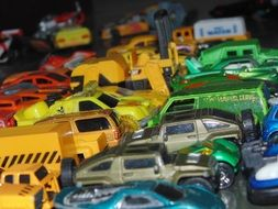 children\'s cars of different colors and models