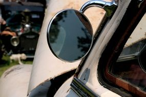 side-view mirror of vintage car