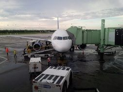passenger airplane in airport on rainy weather