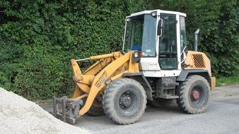 wheel loader on the road